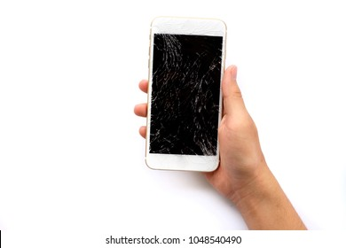 Hands holding broken mobile smartphone with broken screen isolated on white background.