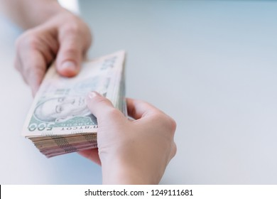hands holding bundle of money. cash payment and bribery. 500 ukrainian hryvnia bills