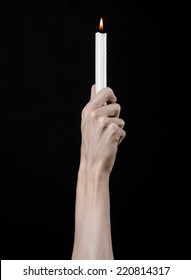 hands holding a candle, a candle is lit, black background, solitude, warmth, in the dark, Hands death, hands witch