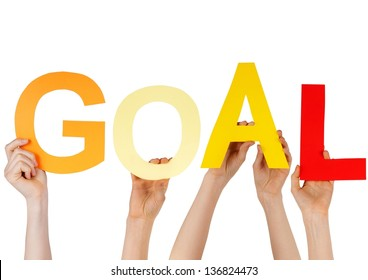 hands holding charakters which are building the word GOAL, isoated
