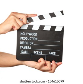 Hands holding Cinema clapboard. Isolated on white