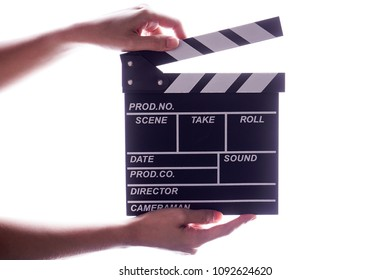 Hands holding clapper board or slate film concept.