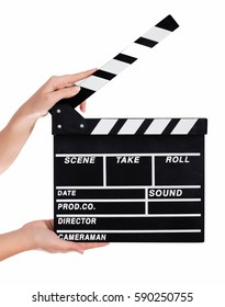 Hands holding a clapper board.Isolated on white