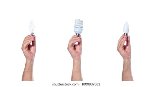 Hands holding classic tungsten incandescent light bulb, fluorescent light bulb, and led eco bulb. The history of evolution of light bulbs on white background isolated