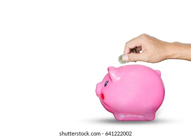 hands holding a coin put on piggy bank saving isolated on white for saving money concept.