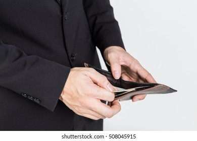 Hands holding coins and wallet. Black wallet and small coins. Not a cent more. The definition of poverty,white isolate.
