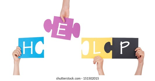 Hands holding a Colorful Puzzle With Help on it, Isolated