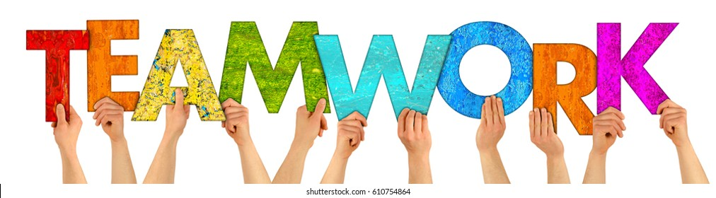 hands holding up colorful wooden letters shaping the word teamwork isolated on white background