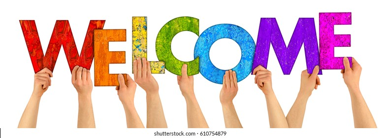 hands holding up colorful wooden letters shaping the word welcome isolated on white background