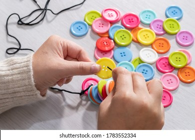 Hands holding a colourful button