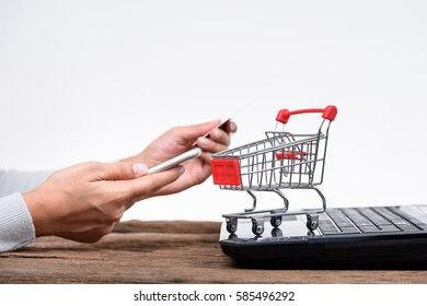 Hands holding credit card and using laptop. Online shopping, isolated on white background