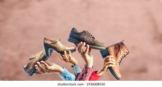 Hands holding different men and women shoes and boots. Concept of selection, purchase and repair of shoes.