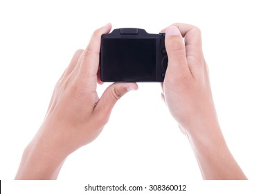 hands holding digital camera with blank screen isolated on white background
