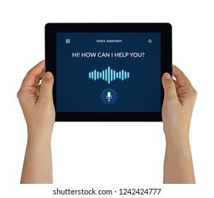 Hands holding digital tablet computer with voice assistant concept on screen. Isolated on white. All screen content is designed by me