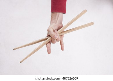 Hands holding drumsticks on a white background.Drum sticks on a white background,