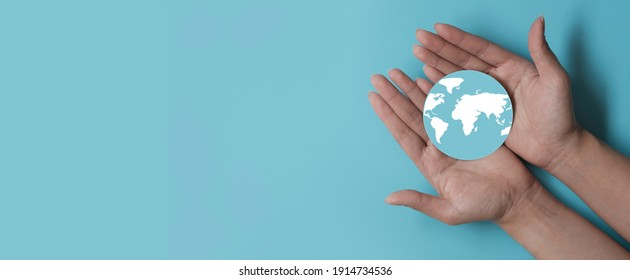Hands holding earth, save planet, earth day, sustainable living, ecology environment, climate emergency action, world environment day concept