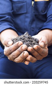 hands holding ecologically controlled re-constituted soil