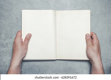 Hands holding empty copy space open book.
