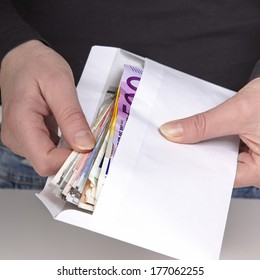 Hands holding envelope with cash