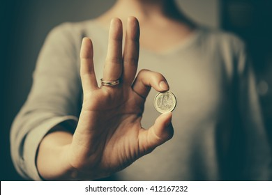 Hands holding european Euro coin. Toned image