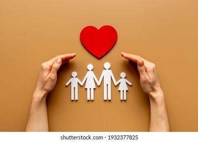 Hands holding family figure. Life and health insurance concept. - Shutterstock ID 1932377825