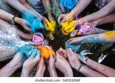hands holding a farba at the Holi Festival   bright colors holi in the hands of children - Shutterstock ID 1693150369