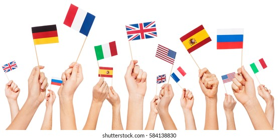 Hands holding flags of USA and EU member-states