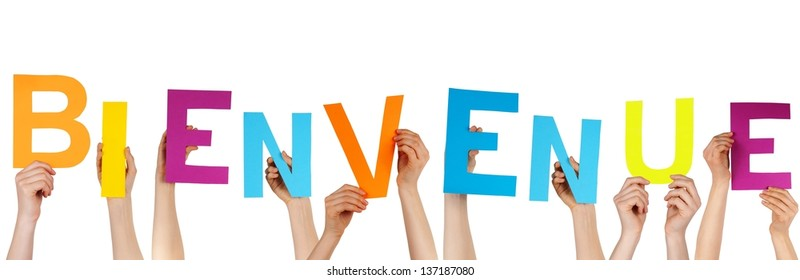 hands holding the french word BIENVENUE which means welcome, isolated