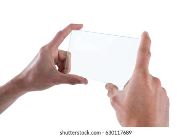 Hands holding futuristic mobile phone against white background
