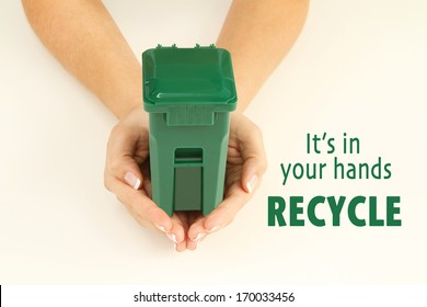Hands holding a garbage can. It's in your hands, recycle.