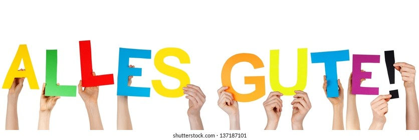hands holding the german word ALLES GUTE! which means congratulations/best wishes, isolated