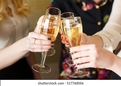 Hands holding the glasses of champagne making a toast