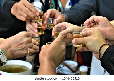 hands holding glasses for drinking and cheering