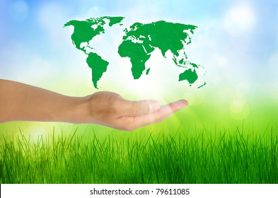 Hands holding globe. Environmental energy concept