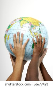Hands holding up a globe, on white background