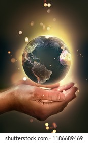 Hands holding a glowing earth - conceptual image of the earth day, saving energy, protecting the environment. Elements of this image furnished by NASA