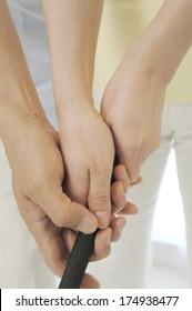 Hands holding a golf club