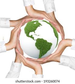 Hands holding green globe