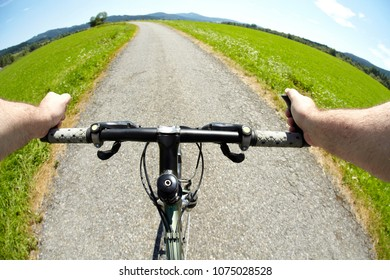 Hands holding handlebar of a bicycle