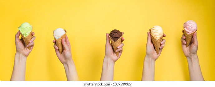 Hands holding ice cream in cones