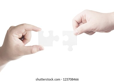 Hands holding jigsaw piece. Business concept for completion for business success