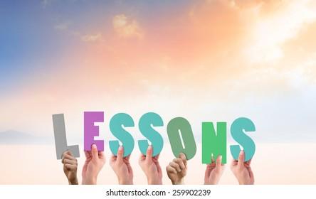 Hands holding up lessons against desert landscape