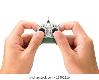Hands holding miniature remote control