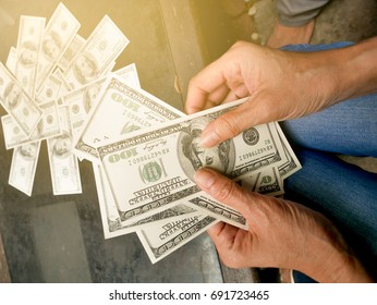 hands holding money about to pay with money on the wood table, money laundering, fraud money, cashing, payment, wealthy person, currency exchange