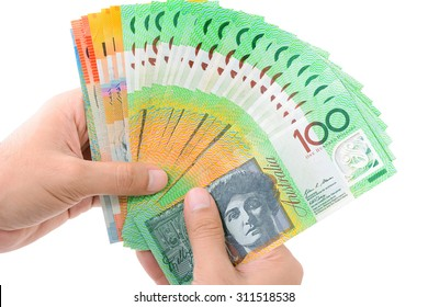 Hands holding money, Australian dollar (AUD) banknotes, isolated on white background