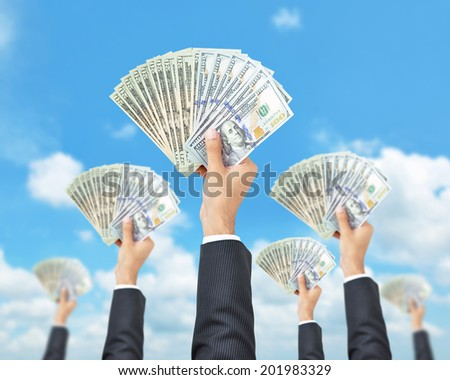 Hands holding money - United States dollar (USD) banknotes - money raising, funding & consumerism concept