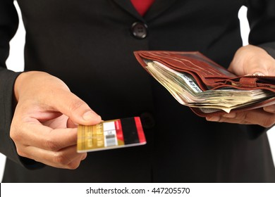 Hands holding money with wallet and credit card