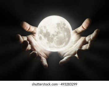 Hands holding moon