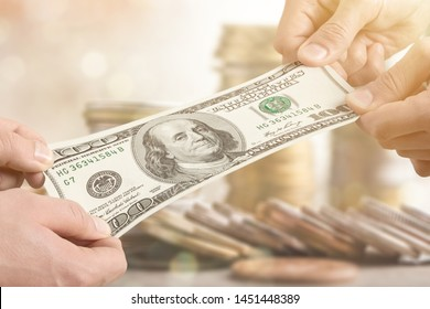 Hands holding one hundred dollars banknote over background