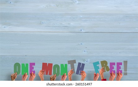 Hands holding up one month free against bleached wooden planks background